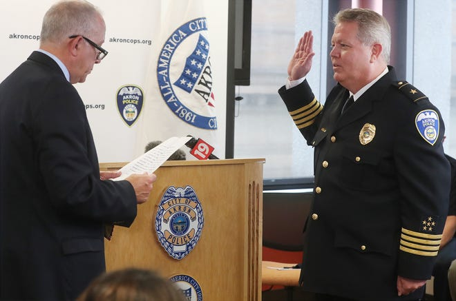 Akron Mayor Dan Horrigan administers the oath of office to Akron Police Chief Steve Mylett on Thursday during a swearing-in ceremony at the Harold Stubbs Safety Building in Akron.