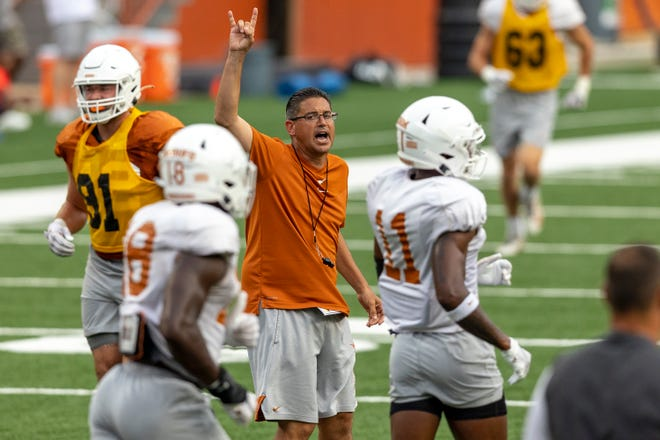 Texas assistant head football coach Jeff Banks barks directions to players during an open practice at Royal-Memorial Stadium last week. Banks said he's eager to start recruiting the state of Texas for the Longhorns; at Alabama, he helped land several key Texas recruits for the Crimson Tide.
