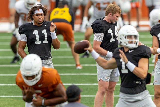 Texas quarterback Casey Thompson (11) watches as quarterback Hudson Card (1) throws during an open practice session for fans at Darrell K Royal-Texas Memorial Stadium, Wednesday, Aug., 18, 2021.