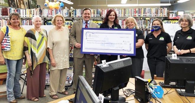 Missouri State Secretary John R. (Jay) Ashcroft presented a check for $21,118 to the Boonslick Regional Library on Tuesday in Boonville. The money will be used to purchase library document stations. On hand during the presentation were (left to right) Linda Runnebaum, Cooper County Board Member, Sandy Meisenheimer, Cooper County Board Member,Mary  Pat Abele, Cooper County Board Member,Secretary of State John R. (Jay) Ashcroft, Cathy Birk, Branch SupervisorLinda Allcorn, Library Director, Jannaka Brown, Library Assistant II, and Vicki Ghea, Library Assistant II.