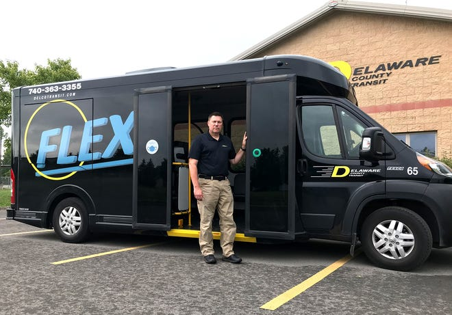 Grant Bias, Delaware County Transit's safety, security and training manager, stands next to one of DCT's FLEX service vehicles. FLEX service was introduced during the COVID-19 coronavirus pandemic and replaces DCT's old fixed routes.