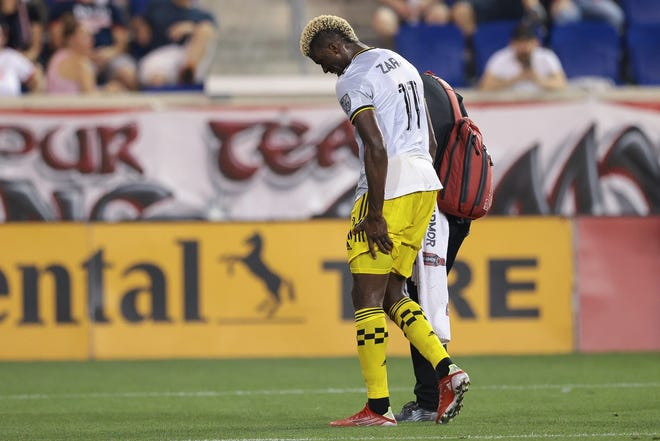 Aug 18, 2021; Harrison, New Jersey, USA; Columbus Crew forward Gyasi Zardes (11) walks off the field after an injury during the first half against the New York Red Bulls at Red Bull Arena. Mandatory Credit: Vincent Carchietta-USA TODAY Sports