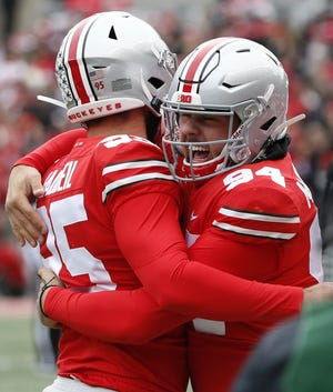 Ohio State Buckeyes long snapper Roen McCullough (94) celebrates with Ohio State Buckeyes place kicker Blake Haubeil (95) after Haubeil successfully kicked an onside kick during the first quarter of a NCAA Division I college football game between the Ohio State Buckeyes and the Maryland Terrapins on Saturday, November 9, 2019 at Ohio Stadium in Columbus, Ohio. [Joshua A. Bickel/Dispatch]