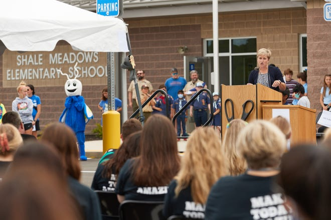 Greta Gnagy, principal at Olentangy Schools' new Shale Meadows Elementary School, speaks to an audience during an Aug. 15 open house at the school, 4458 North Road in Berlin Township. Shale Meadows, the district's 16th elementary school, opened Aug. 19 for the start of the 2021-22 school year.