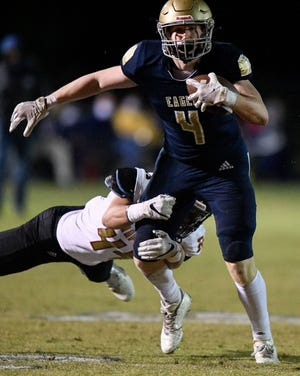 Independence's Ty Lockwood (4) is brought down by Ravenwood's Andrew Dudas (44) during the second half at Independence High School in Thompson's Station, Tenn., Friday, Oct. 30, 2020.