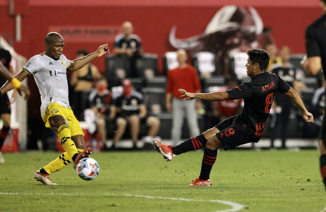 Aug 18, 2021; Harrison, New Jersey, USA; Columbus Crew midfielder Darlington Nagbe (6) blocks the shot attempt of New York Red Bulls midfielder Frankie Amaya (8) during the second half at Red Bull Arena. Mandatory Credit: Vincent Carchietta-USA TODAY Sports