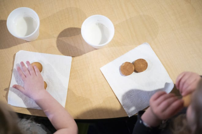 Kids enjoy a snack of Nilla Wafers and milk on Tuesday, Mar. 16, 2021 at Nikki's Family Childcare and Preschool in Gnadenhutten, Ohio. A child tax credit in the American Rescue Act has the potential to greatly impact children and childcare providers in rural areas.