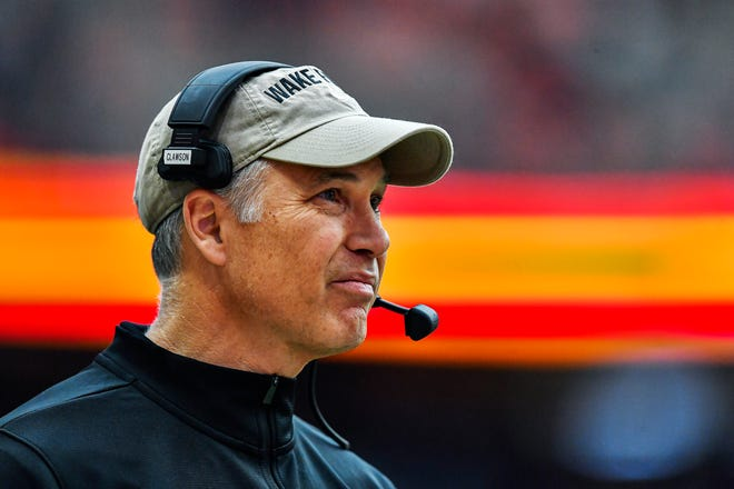 FILE - Wake Forest head coach Dave Clawson watches from the sideline during the first half of an NCAA college football game against Syracuse in Syracuse, N.Y., in this Saturday, Nov. 30, 2019, file photo. The Demon Deacons return nine starters on both offense and defense. (AP Photo/Adrian Kraus, File)