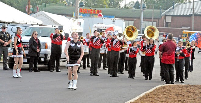 Members of the Orrville High School marching band play patriotic songs at a previous Wayne County Fair opening ceremony. Orrville, along with nine other Wayne County high school bands, will perform Monday morning, Sept. 13 in front of the grandstand at this year's Wayne County Fair.
