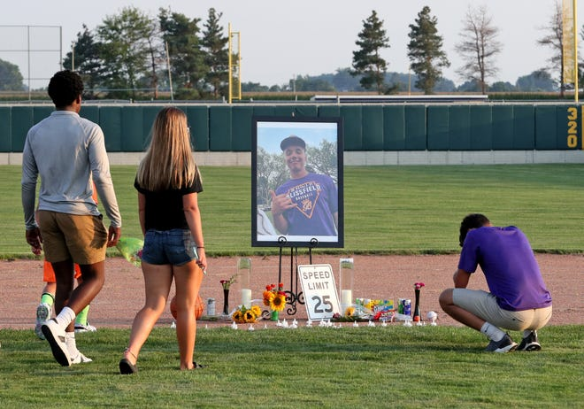 A memorial to honor the life of Trent Allan Freudenberg, 17, of Blissfield, who was killed Sunday in an automobile crash in Madison Township, was placed at second base Wednesday evening at the Blissfield High School baseball field. A candlelight vigil was held Wednesday to remember the rising senior at Blissfield High School.