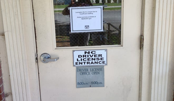 A sign announcing the DMV office on South Main Street in Lexington is closed due to a lack of staff. Representatives from the organization state three employees at different locations have been exposed to COVID-19