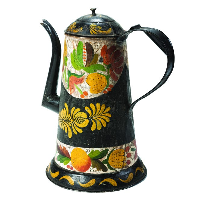 This 19th-century 10-inch-high painted tin coffeepot sold in a Cowan auction for $544.