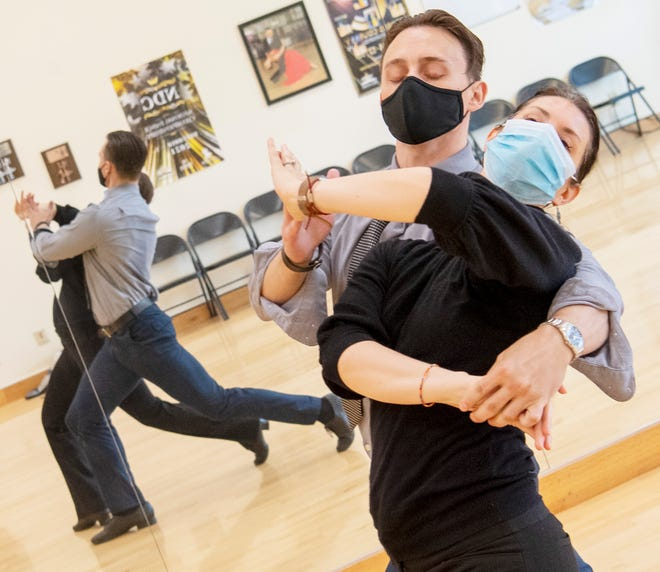 Dmitriy Volodko and Erin Parks practice their ballroom dancing at Fred Astaire Studio on Wednesday, August 18, 2021.