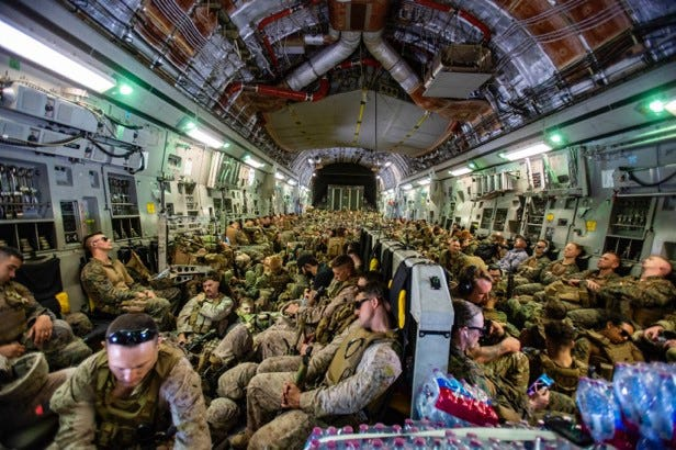 Marines assigned to the 24th Marine Expeditionary Unit fly to Hamid Karzai International Airport, Kabul, Afghanistan, Aug. 17, 2021.