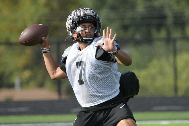 Macon junior quarterback MyKel Linear winds up for a throw during practice drills on Tuesday, Aug. 17.