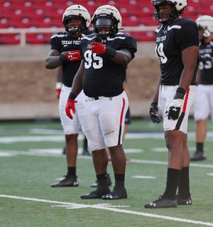 Nose attack Jaylon Hutchings (95) and Tyree Wilson, on the right, start again on the Texas Tech defensive line.