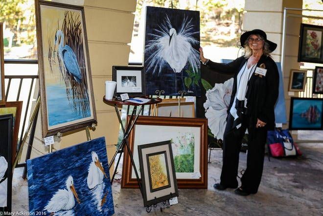 Mary Andeline displays some of her work from previous shows.