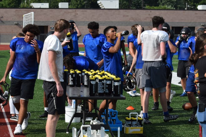 Leavenworth High School football players stay hydrated during an afternoon practice Wednesday.