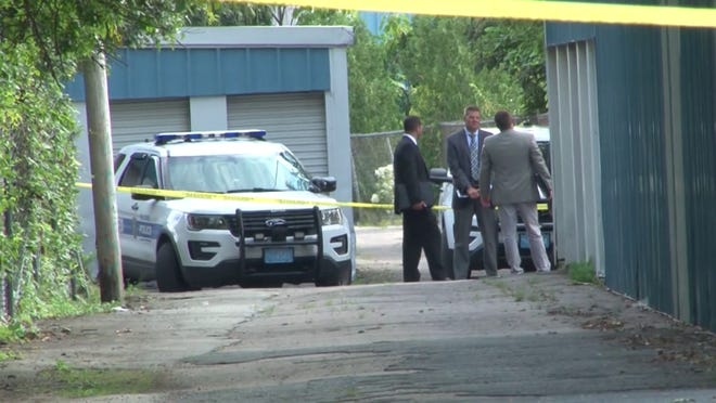 Investigators at a storage facility in Milford where a body was found on Tuesday.
