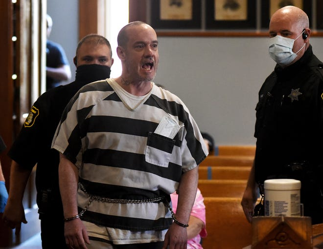 """Kenny W. McBride, 45, of Temperance yells at 38th Circuit Court Chief Judge Michael A. Weipert as he enters Weipert's courtroom Thursday accompanied by several Monroe County Sheriff's deputies. McBride was sentenced to life in prison without the possibility of parole for the murder of Cecilia """"Nickie"""" Gibson."""