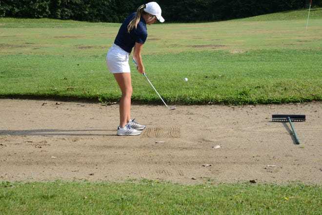 Ashlyn Bondy of Airport hits out of a sand trap on the second hole of the Jefferson Invitational at Big Al's Greens and Grille.
