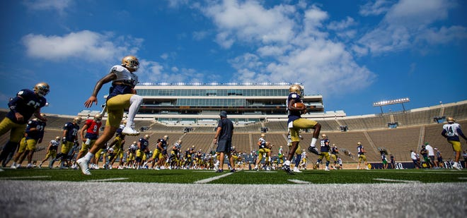 Notre Dame players warm up before football practice Thursday, Aug. 19, 2021 at Notre Dame Stadium in South Bend.