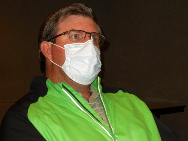 Michael Callender, general manager of Tennessee Centennial Golf Course, sits masked after having addressed Oak Ridge City Council on his course at an August work session.