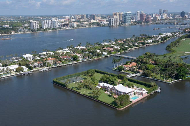 Seen in the foreground is Tarpon Island, a private island in Palm Beach that was sold last month to developer Todd Michael Glaser for $85 million. Glaser plans to demolish a portion of the existing residence on the island and build an 18,000-square-foot, two-story addition.