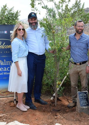 Dinie and Rabbi Moshe Scheiner plant a tree with Israel Ganz, governor of the Shiloh region, during Palm Beach Synagogue's recent trip to Israel.