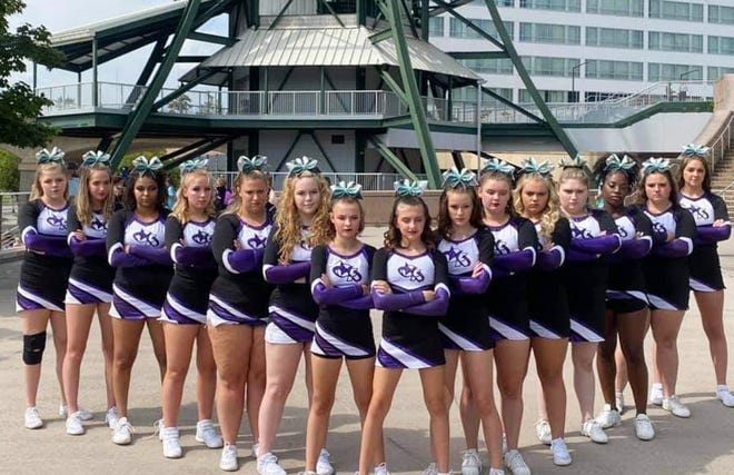 The Lady Rain BCP Cheer team pose before the start of day two of competition in Knoxville, before earning a NYAA Level 6 National Championship. Team members include (from left) Lauren Hudson , Caroline Gilling, Aliyah Holmes, Autumn Stutzman, Karizma Simon, Jacey Schweifler, Bricelyn Glezman, Denny Taylor, Alexaundria Gofourth, Marley Grangood, Gabriella Jorgensen, Kyrsten, Shadain Pink, Tegan Elkins and Leona Follette.