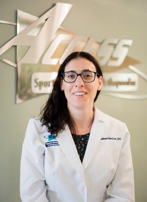 Dr.  Chelsea Backer
