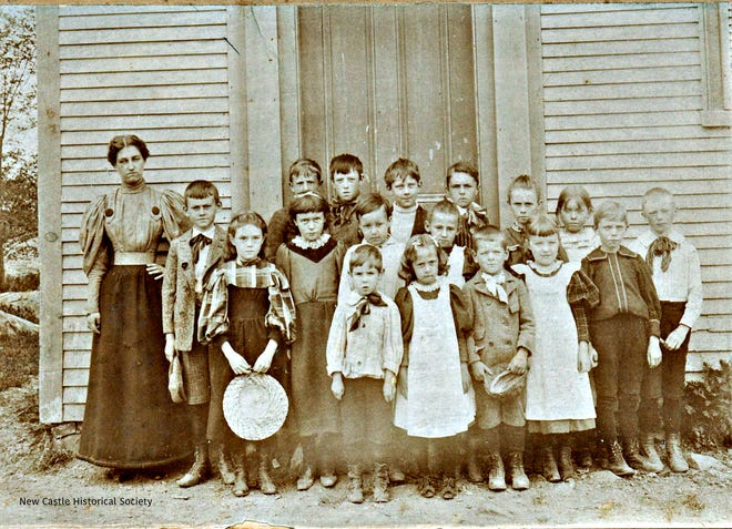 """Maude H. Trefethen around 1898 with primary school students at the old schoolhouse that stood in the center of New Castle. """"Miss Maude"""" taught the """"low school"""" for 51 years and the current elementary school is named in her honor."""