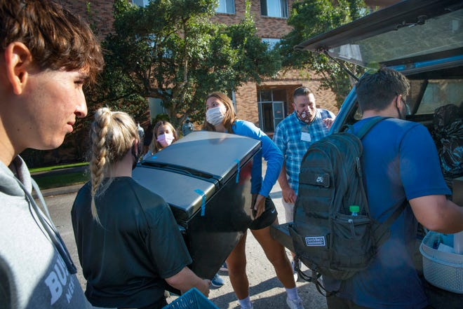 Bushnell University student volunteers help new students and their parents move belongings into the dormitories at the school in Eugene as the 2021 academic year begins.