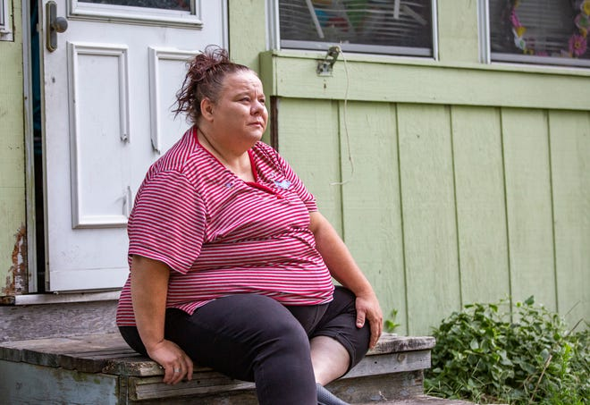 Janell Apple sits outside her home on Wednesday, Aug. 18, 2021, in South Bend.