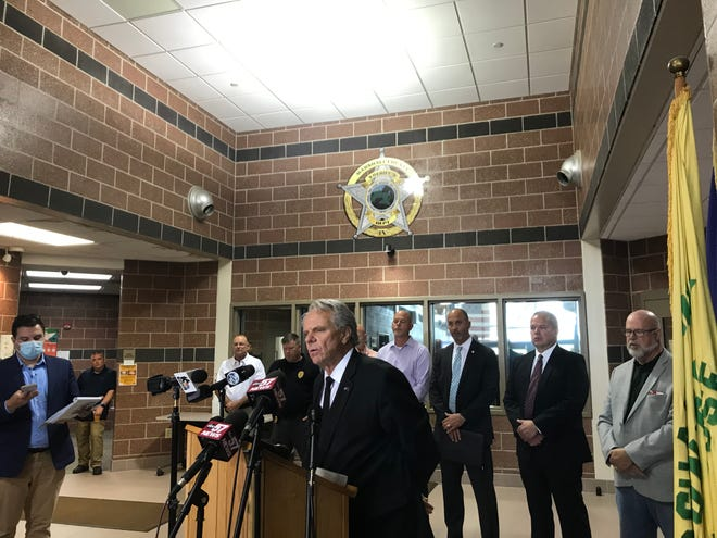 Marshall County Prosecutor Nelson Chipman speaks at a news conference Thursday