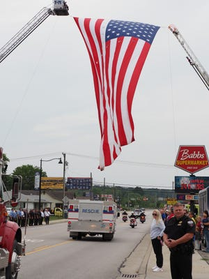 Residents gathered along the procession route in town to honor fallen hero, Owen County EMT Brandon Staley, who tragically lost his life while in the line of duty. More photos are featured in today's SEW.