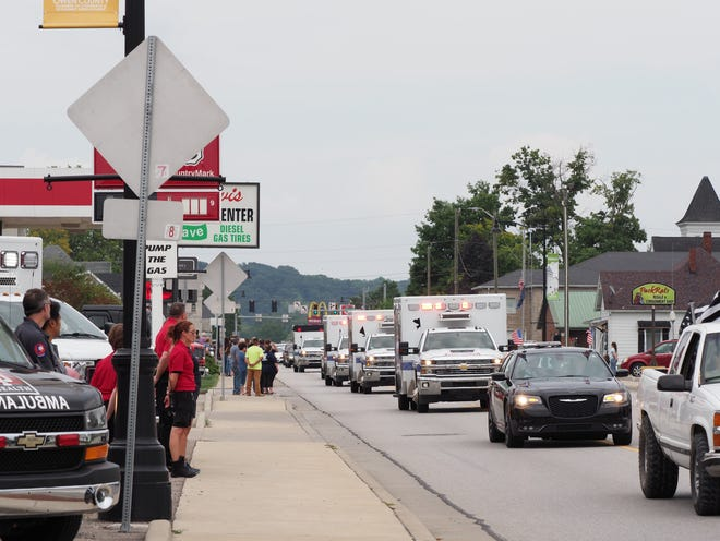 A line of ambulances and other first responder vehicles and those of family and friends joined in the procession to honor fallen hero Brandon Staley as it made its way through Spencer Wednesday afternoon.