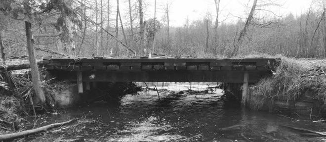 An aging bridge over the Milakokia River will be replaced by a new timber bridge.
