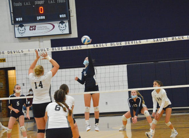 Sault High setter Hannah Burd (2) tips the ball over the net during a match against Cheboygan last season. The Blue Devils open the 2021 season with a invitational tournament at home this Saturday.