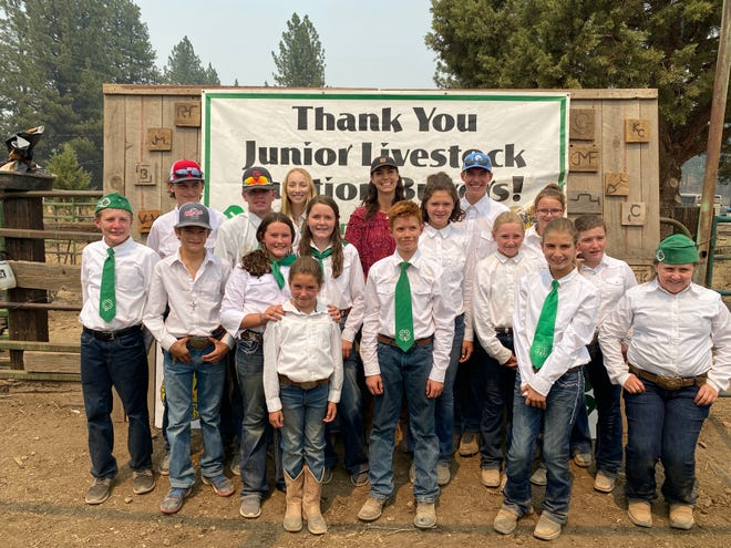 Mary Heffernan of Five Mary's Farm in Fort Jones poses with members of the  Indian Valley 4-H Club on Sunday, Aug. 15., 2021.