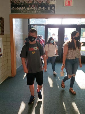 A new school year dawned Wednesday morning at Wethersfield High School as students, wearing the required masks, entered the building for the first time since last May. Students ofDistrict 230 and Kewanee Dist. 229 schools will attend five full days of in-person learning with COVID restrictions relaxed somewhat from last spring.
