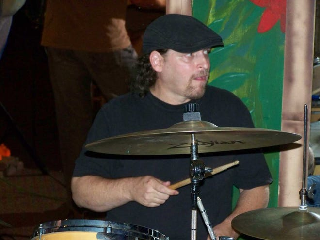 Steve Hill at his favorite place, behind the drums.