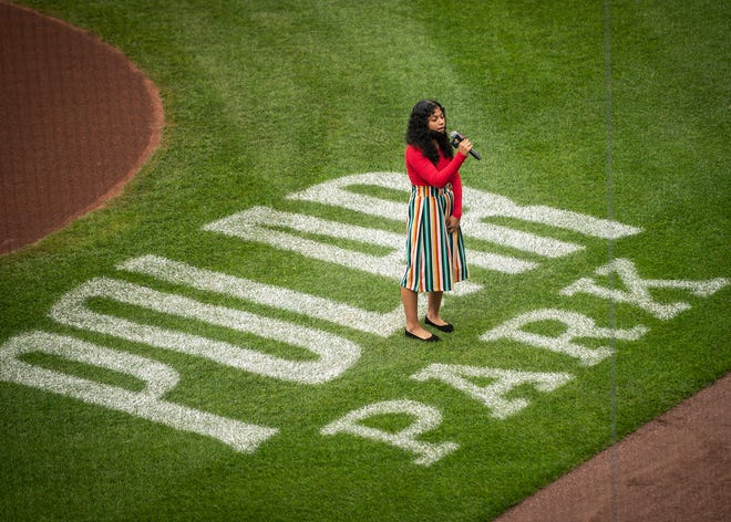 Bethany Jimenez, 16, a junior at North High, sings the national anthem before Thursday night's doubleheader at Polar Park.