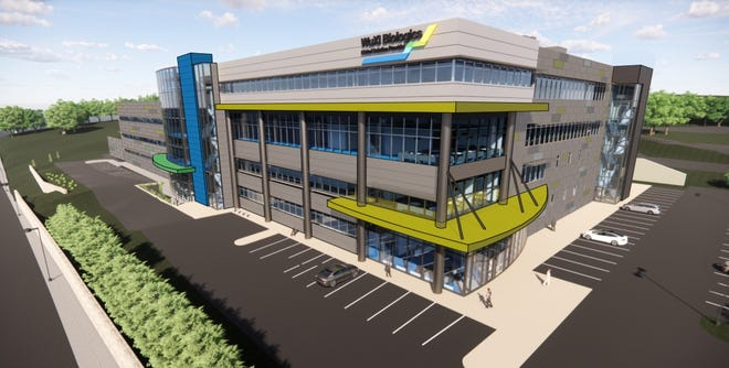 WuXi Biologics received approval Wednesday to significantly expand its plan to build a biomanufacturing plant at The Reactory on Belmont Street.