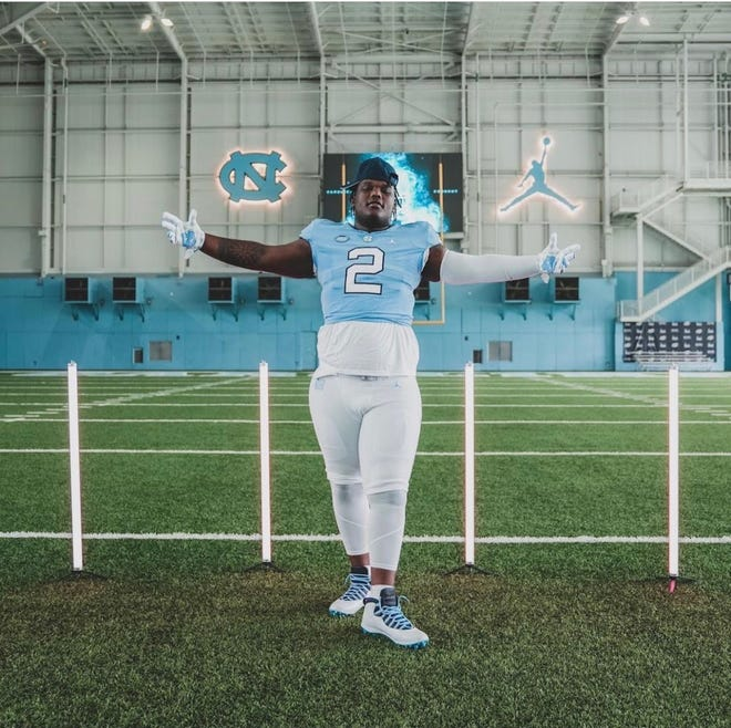 Five-star 2022 Grimsley defensive tackle Travis Shaw unofficially visited UNC football for its Carolina Cookout event in late July. The Tar Heels now project as an industry favorite to land Shaw, who is announcing between UNC, Clemson, Georgia and N.C. A&T during an Aug. 21 ceremony at his high school in Greensboro.
