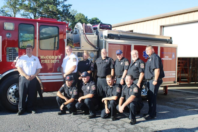 Members of the McCords Crossroads Volunteer Fire Department are pictured Tuesday with the Cherokee County department's new fire truck. Standing from left are Chief Rich Lindsey, Assistant Chief Barry Rogers, Jr., Karen Bobo, Dwight Bobo, Lamar Montgomery, Barry Rogers Sr. and Jay Hood. Kneeling are Dustin Kerr, Dalton Kerr, Zack Hammond and Jimmy Wayne Smith.