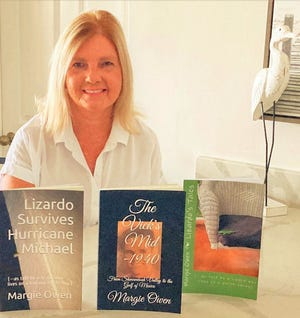 """Local author Margie Owen displays her books, including """"The Vick's Mid-1940,"""" an ongoing series."""