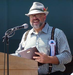 Bratwurst Festival Director Kevin Myers speaks during the event's opening ceremony on Thursday.