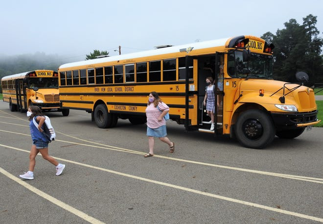 Children come off a school bus at Warsaw Elementary School, part of River View Local Schools. All three of Coshocton County's school districts report being okay with regular drivers, but the lack is substitutes to cover regular drivers being off or helping with afterschool activities like away sports games.