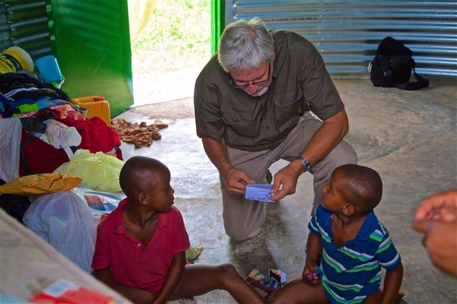 Ken DeYoung with Haitian children.